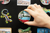 New fridge magnet from the last vacation (Putting a new travel magnet on the refrigerator). Magnets without names of places.