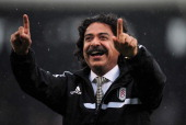 New Fulham Chairman Shahid Khan is greeted by fans ahead of the Barclays Premier League match between Fulham and Arsenal at Craven Cottage on August...