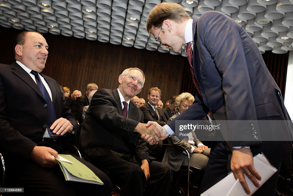 New German Bundesbank President Jens Weidmann (R) shakes hands with Finance Minister Wolfgang Schaeuble as his predecessor Axel Weber smiles during a hand-over ceremony at the Bundesbank headquarters on May 2, 2011 in Frankfurt am Main, Germany. Today Weidmann is on his first day on the job at the Bundesbank and replaces Axel Weber, who announced he would step down in February due to personal reasons.