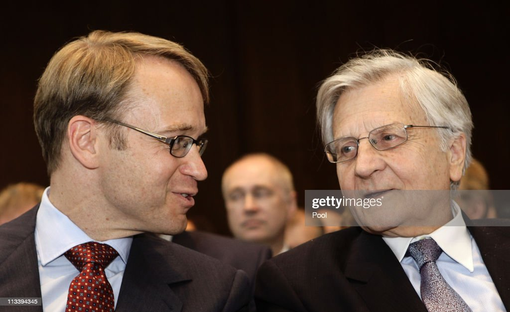 New German Bundesbank President Jens Weidmann (L) talks to European central Bank President <a gi-track='captionPersonalityLinkClicked' href=/galleries/search?phrase=Jean-Claude+Trichet&family=editorial&specificpeople=208778 ng-click='$event.stopPropagation()'>Jean-Claude Trichet</a> during a hand-over ceremony at the Bundesbank headquarters on May 2, 2011 in Frankfurt am Main, Germany. Today Weidmann is on his first day on the job at the Bundesbank and replaces Axel Weber, who announced he would step down in February due to personal reasons.