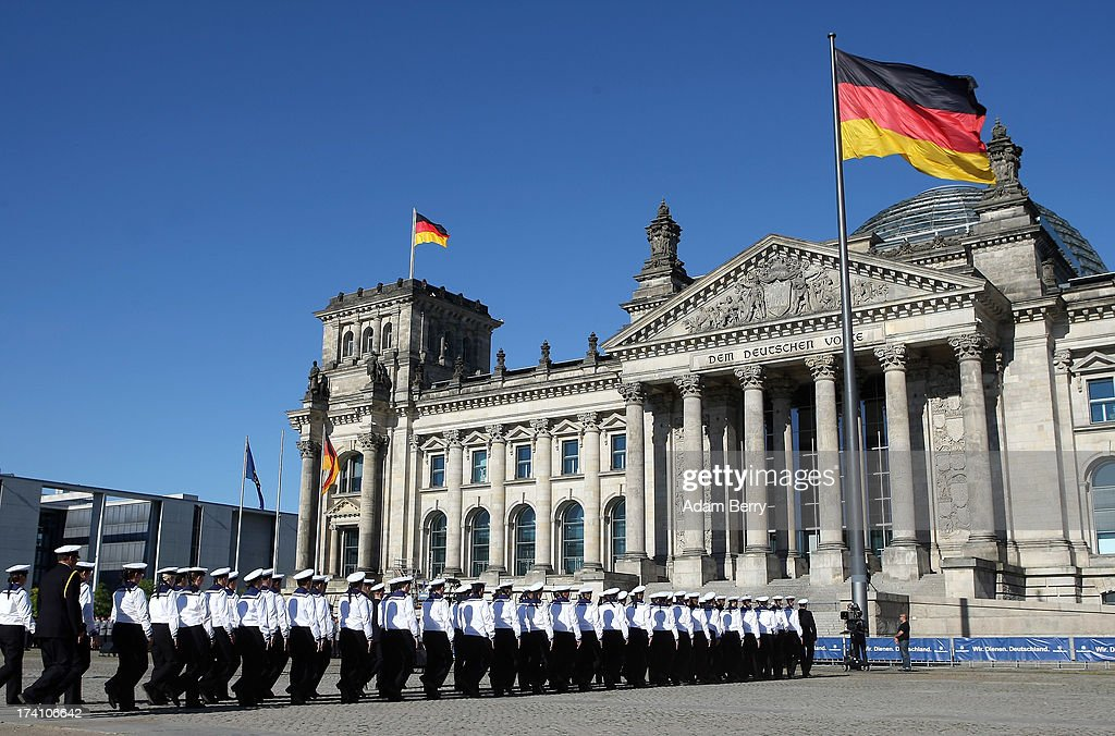 New German Bundeswehr soldiers arrive for a swearing-in ceremony for new recruits of the Bundeswehr, the armed forces of the Federal Republic of Germany, in front of the Reichstag building on July 20, 2013 in Berlin, Germany. In the annual ceremony, new soldiers take office on the anniversary of the assassination attempt on Adolf Hitler by Claus Schenk Graf von Stauffenberg.