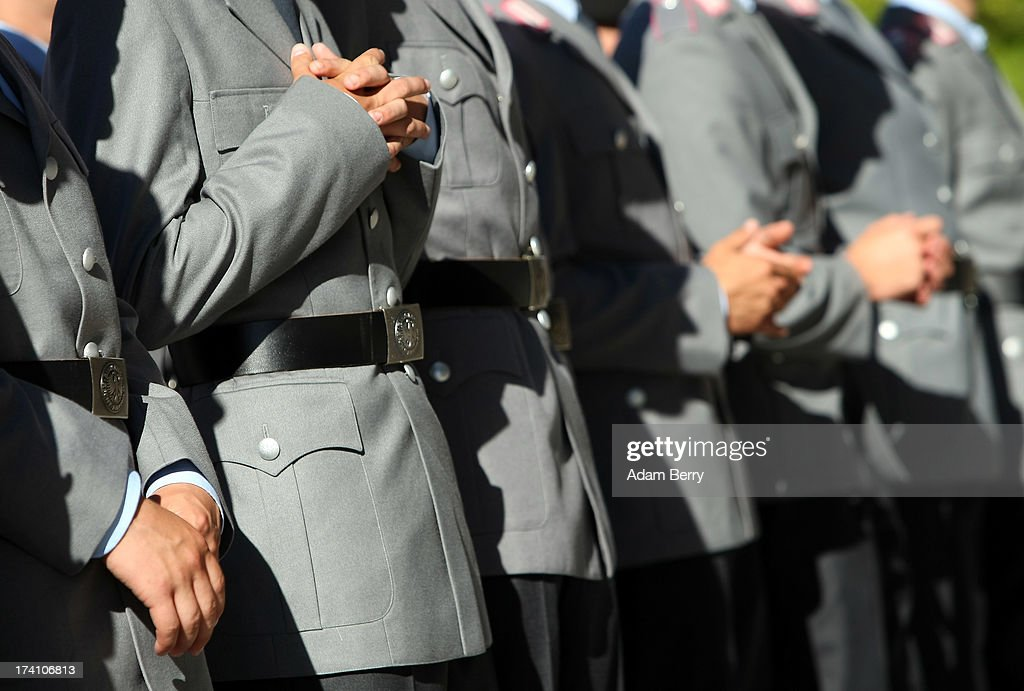 New German Bundeswehr soldiers wait for the start of a swearing-in ceremony for new recruits of the Bundeswehr, the armed forces of the Federal Republic of Germany, in front of the Reichstag building on July 20, 2013 in Berlin, Germany. In the annual ceremony, new soldiers take office on the anniversary of the assassination attempt on Adolf Hitler by Claus Schenk Graf von Stauffenberg.