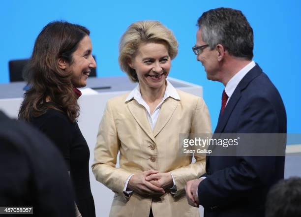 New German Defense Minister Ursula von der Leyen chats with outgoing Defense Minister Thomas de Maiziere and new Integration Commissioner Aydan...