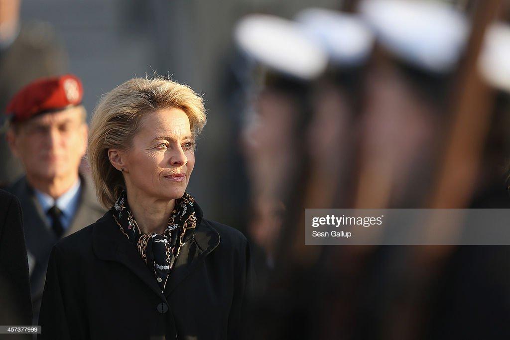 New German Defense Minister <a gi-track='captionPersonalityLinkClicked' href=/galleries/search?phrase=Ursula+von+der+Leyen&family=editorial&specificpeople=4249207 ng-click='$event.stopPropagation()'>Ursula von der Leyen</a> watches as Bundeswehr soldiers parade past shortly after she took office at the Defense Ministry on the day the new German government was sworn in on December 17, 2013 in Berlin, Germany. The new government is a coalition between the German Christian Democrats (CDU), the Bavarian Christian Democrats (CSU) and German Social Democrats (SPD) following federal elections held in September.