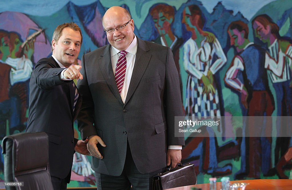 New German Environment Minister Peter Altmaier (R) and Health Minister <a gi-track='captionPersonalityLinkClicked' href=/galleries/search?phrase=Daniel+Bahr&family=editorial&specificpeople=7622444 ng-click='$event.stopPropagation()'>Daniel Bahr</a> arrive for his first German government weekly cabinet meeting since his appointment on May 23, 2012 in Berlin, Germany. Altmaier, who succeeds Norbert Roettgen, will have the formidable task of helping German Chancellor Angela Merkel execute her transfer of Germany towards renewable energy sources.