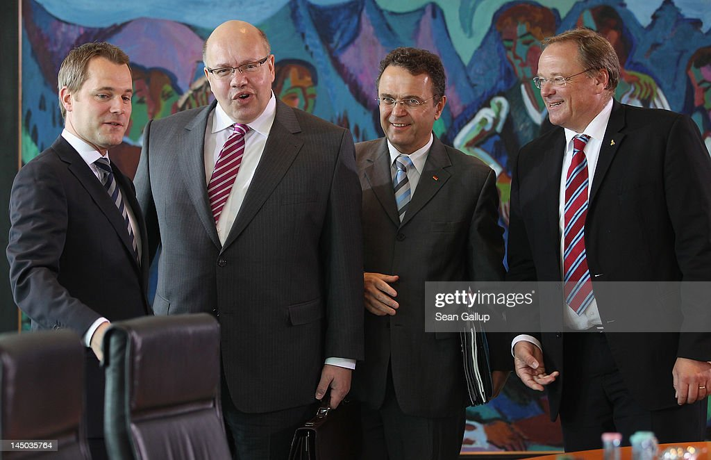 New German Environment Minister Peter Altmaier (2nd from L) stands with (from L to R) Health Minister <a gi-track='captionPersonalityLinkClicked' href=/galleries/search?phrase=Daniel+Bahr&family=editorial&specificpeople=7622444 ng-click='$event.stopPropagation()'>Daniel Bahr</a>, Interior Minister <a gi-track='captionPersonalityLinkClicked' href=/galleries/search?phrase=Hans-Peter+Friedrich&family=editorial&specificpeople=7528072 ng-click='$event.stopPropagation()'>Hans-Peter Friedrich</a> and Development Minister Dirk Niebel upon their arrival for Atmaier's first German government weekly cabinet meeting since his appointment on May 23, 2012 in Berlin, Germany. Altmaier, who succeeds Norbert Roettgen, will have the formidable task of helping German Chancellor Angela Merkel execute her transfer of Germany towards renewable energy sources.