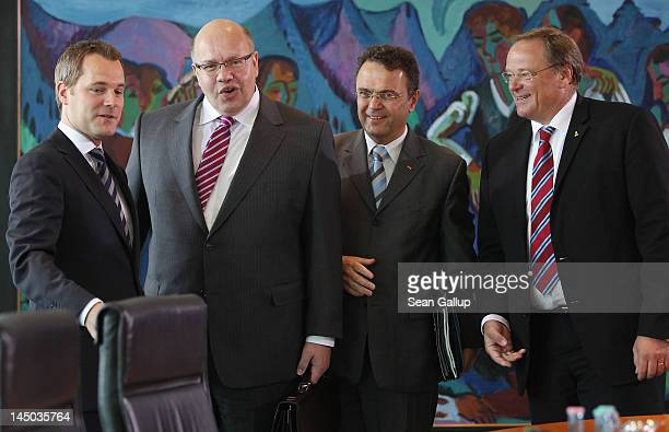 New German Environment Minister Peter Altmaier stands with Health Minister Daniel Bahr Interior Minister HansPeter Friedrich and Development Minister...