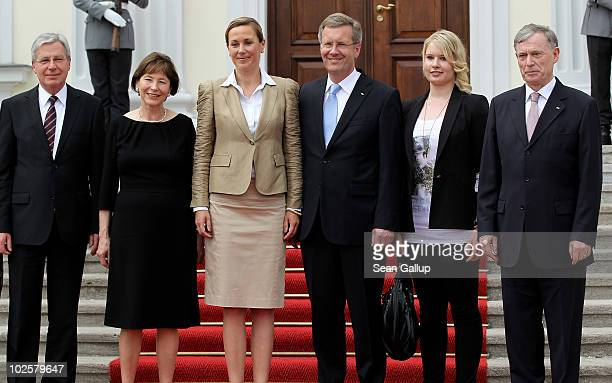 New German President Christian Wulff and his wife First Lady Bettina Wulff pose with outgoing interim President Jens Boehrnsen former First Lady Eva...