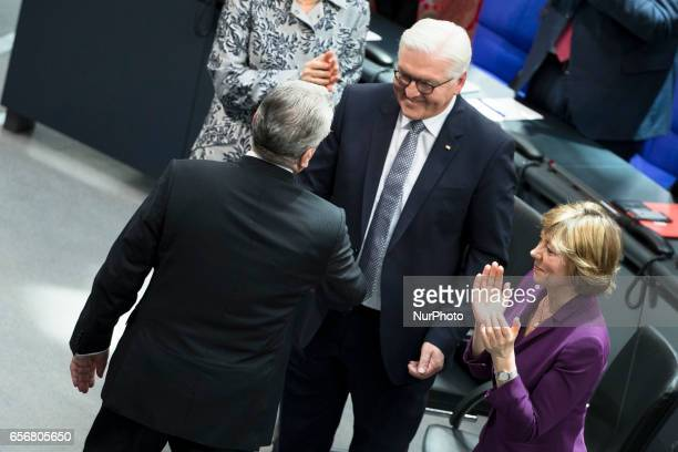 New German President FrankWalter Steinmeier shakes hands with former President Joachim Gauck after his speech during the swearingin ceremony at a...