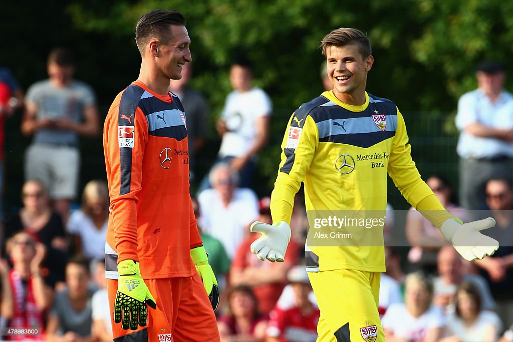 New goalkeepers Mitch Langerak (R) and Przemyslaw Tyton chat during the first training session of VfB Stuttgart at Robert-Schlienz-Stadion on June 29, 2015 in Stuttgart, Germany.