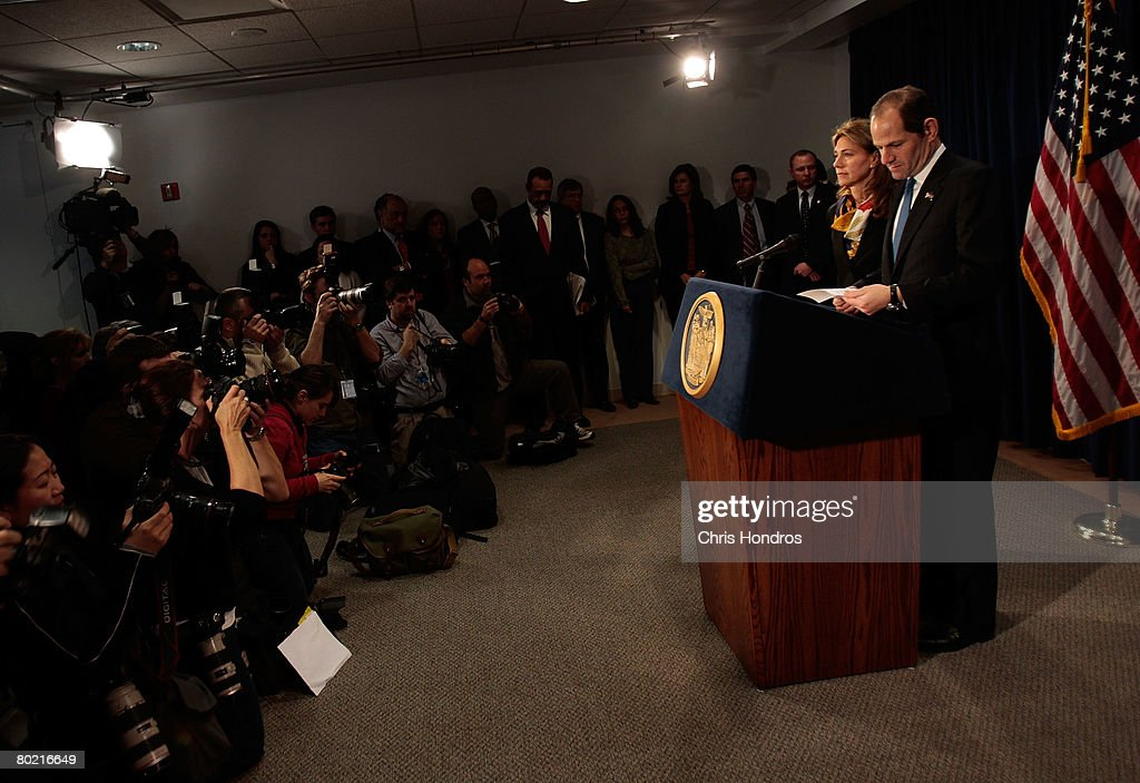 New Governor Eliot Spitzer announces his resignation as his wife Silda Wall Spitzer stands next to him March 12, 2008 in New York City. New York Lieutenant Governor David Paterson will take over for Spitzer when his resignation goes into effect Monday, March 17, 2008.