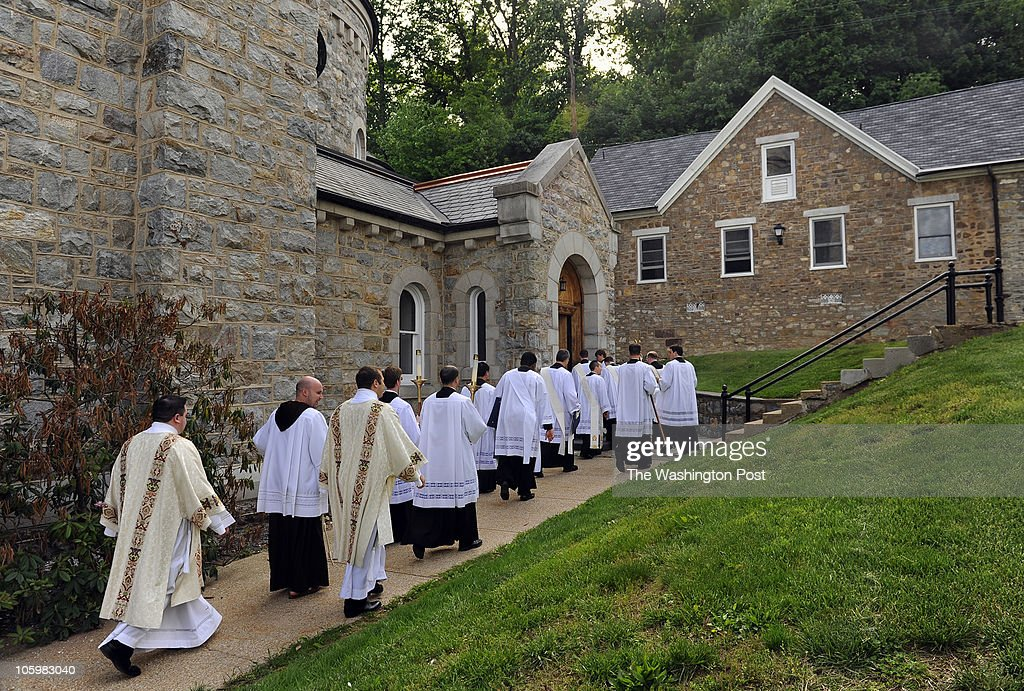 New graduates of the Mount St Mary's Seminary enter the back of the Immaculate Conception Chapel to regroup for a class photo May 7 2010 Emmitsburg MD