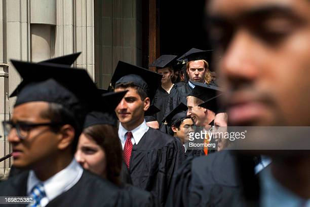 New graduates walk out of the chapel after their commencement at Princeton University in Princeton New Jersey US on Sunday June 2 2013 Ben S Bernanke...