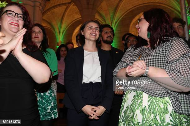 New Green Party MP Chloe Swarbrick listens to leader James Shaw at St Matthews in the City on September 23 2017 in Auckland New Zealand Voters head...