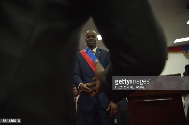 New Haitian President Jovenel Moise shakes hands after receiving his sash during his Inauguration at the Haitian Parliament in PortauPrince on...