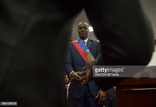 New Haitian President Jovenel Moïse shakes hands after receiving his sash during his Inauguration at the Haitian Parliament in PortauPrince on...