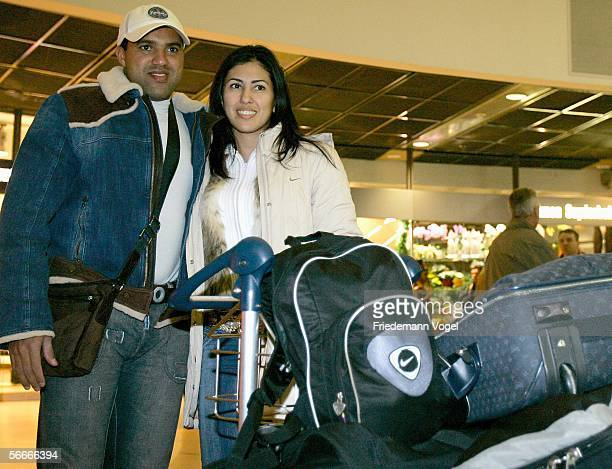 New Hamburg player Ailton of Brazil arrives with his wife Rosali at Hamburg International airport on January 25 2006 in Hamburg Germany