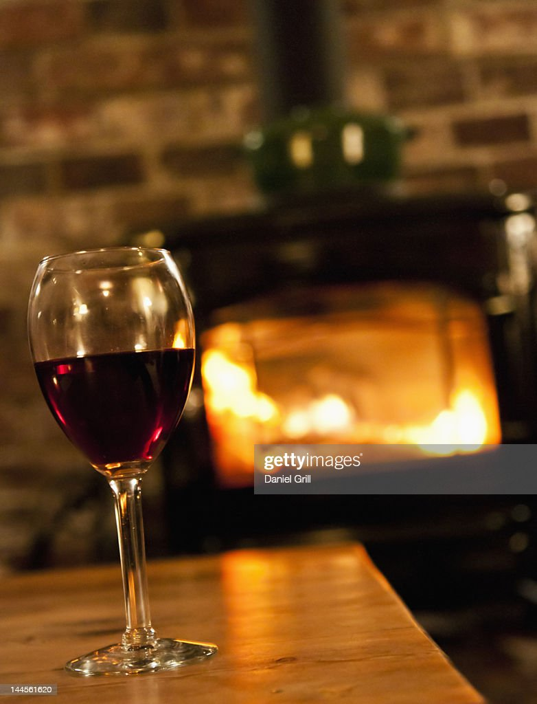 USA, New Hampshire, Lincoln, wine glass with fireplace in background