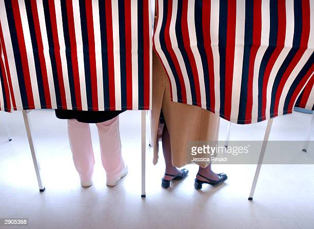 New Hampshire voters in Manchester's Ward 2 place their votes for a Democratic Presidential Candidate at Hillside Middle School January 27 2004 in...