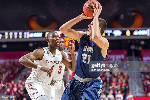 New Hampshire Wildcats forward Tanner Leissner leans back to shoot during the game between the Temple Owls and the University of New Hampshire...