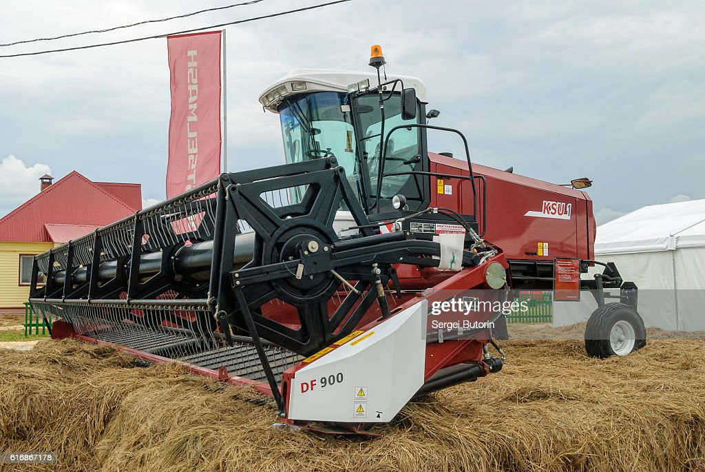 New harvester stands on an exhibition platform : Stock Photo