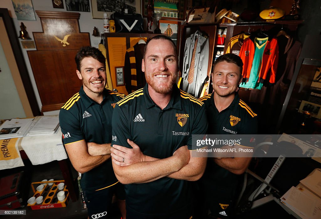 New Hawks captain Jarryd Roughead (centre) and vice-captains Isaac Smith (left) and Liam Shiels (right) pose for a photograph during a Hawthorn Hawks AFL press conference and training session at Waverley Park on January 20, 2017 in Melbourne, Australia.