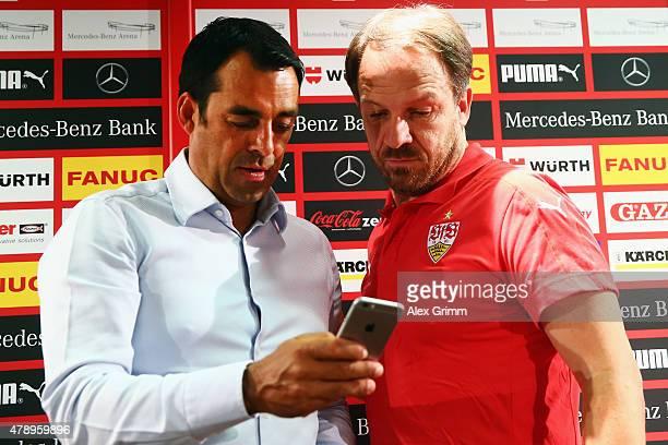New head coach Alexander Zorniger and manager Robin Dutt attend a VfB Stuttgart press conference at MercedesBenz Arena on June 29 2015 in Stuttgart...