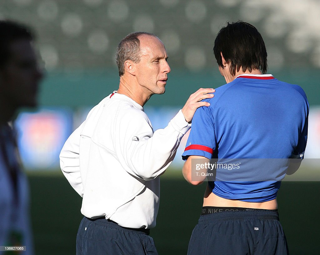 New head coach Bob Bradley has a friendly word with Sacha Kljestan of Chivas USA US men's national team practiced at Home Depot Center in Carson...
