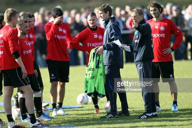 New head coach Christoph Daum speaks to the team during a training session on the training ground at the Commerzbank Arena on March 23 2011 in...