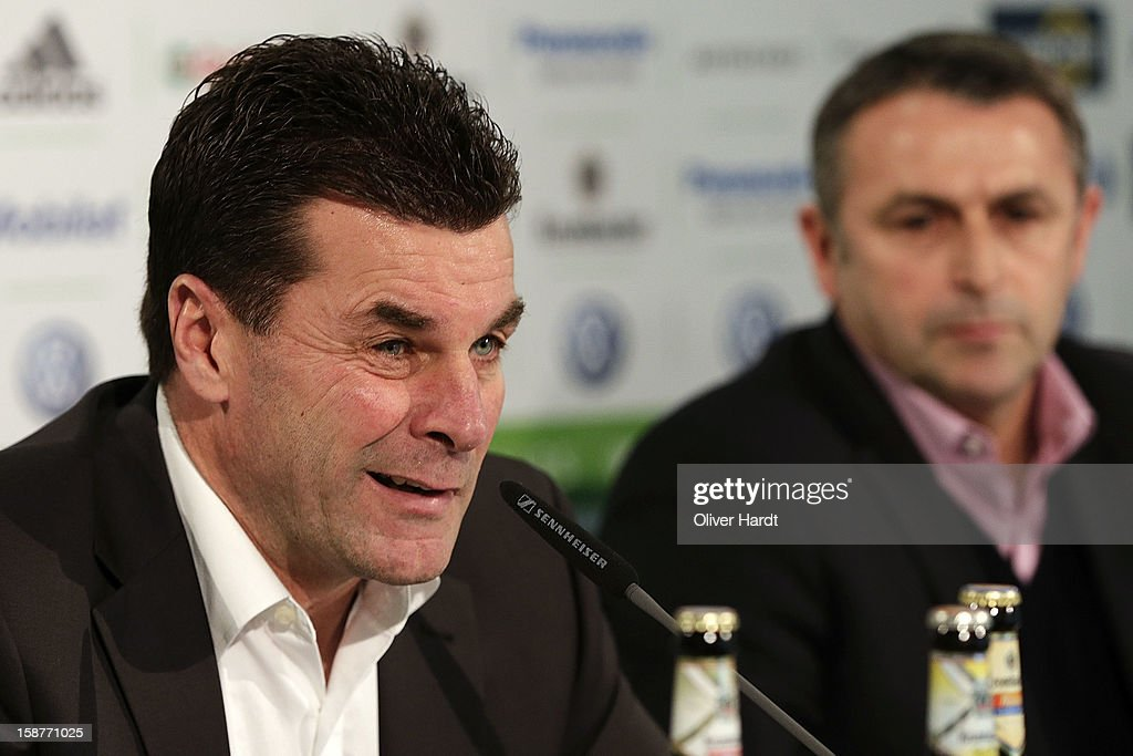 New head coach <a gi-track='captionPersonalityLinkClicked' href=/galleries/search?phrase=Dieter+Hecking&family=editorial&specificpeople=535775 ng-click='$event.stopPropagation()'>Dieter Hecking</a> of VfL Wolfsburg attends a press conference with sporting director <a gi-track='captionPersonalityLinkClicked' href=/galleries/search?phrase=Klaus+Allofs&family=editorial&specificpeople=634763 ng-click='$event.stopPropagation()'>Klaus Allofs</a> (R) at Volkswagen Arena on December 28, 2012 in Wolfsburg, Germany.