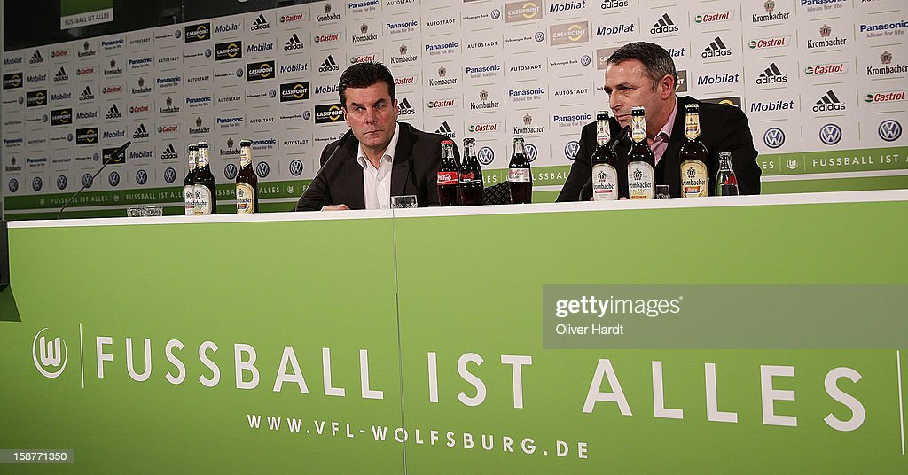 New head coach <a gi-track='captionPersonalityLinkClicked' href=/galleries/search?phrase=Dieter+Hecking&family=editorial&specificpeople=535775 ng-click='$event.stopPropagation()'>Dieter Hecking</a> of VfL Wolfsburg attends a press conference with sporting director Klaus Allofs (R) at Volkswagen Arena on December 28, 2012 in Wolfsburg, Germany.