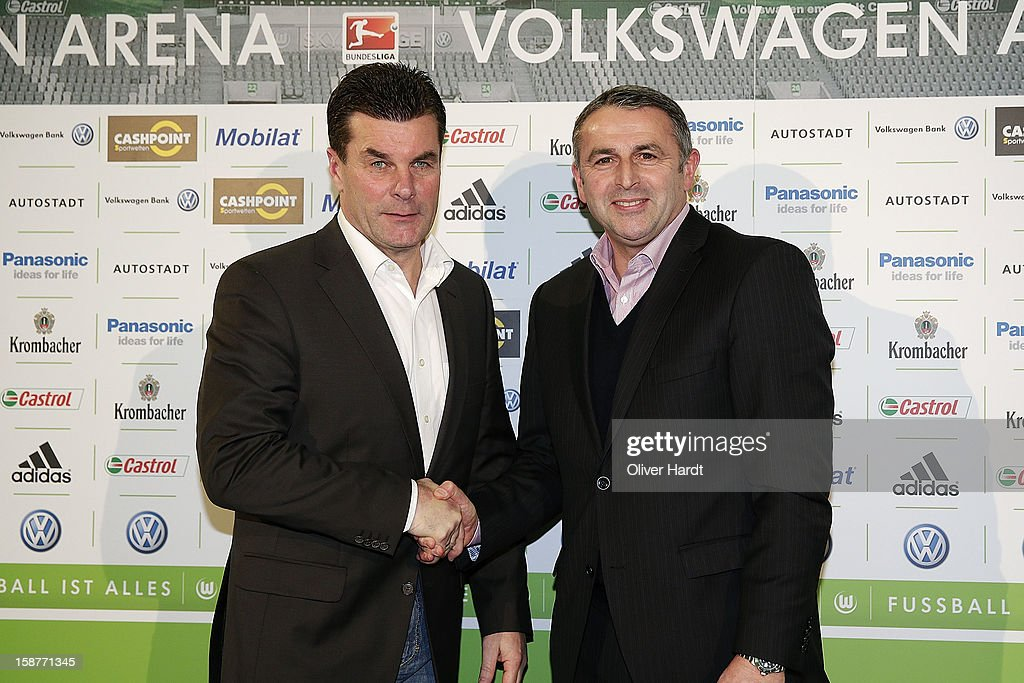 New head coach <a gi-track='captionPersonalityLinkClicked' href=/galleries/search?phrase=Dieter+Hecking&family=editorial&specificpeople=535775 ng-click='$event.stopPropagation()'>Dieter Hecking</a> of Vfl Wolfsburg shakes hands with Sporting director <a gi-track='captionPersonalityLinkClicked' href=/galleries/search?phrase=Klaus+Allofs&family=editorial&specificpeople=634763 ng-click='$event.stopPropagation()'>Klaus Allofs</a> during a press conference at Volkswagen Arena on December 28, 2012 in Wolfsburg, Germany.