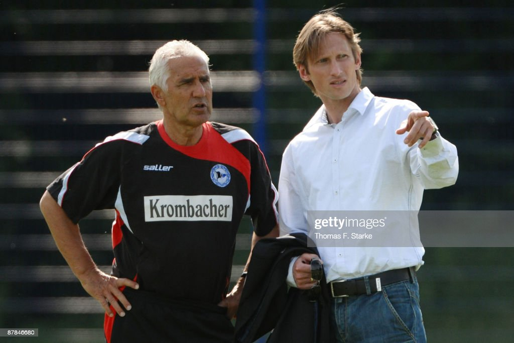 New head coach Joerg Berger and sports director Detlev Dammeier talk during a training session of Bundesliga football club Arminia Bielefeld at the...