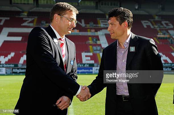 New head coach Krassimir Balakov shake hands with Stefan Kuntz of Kaiserslautern during the new head coach presentation on March 22 2012 in...