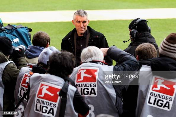 New head coach Mirko Slomka of Hannover is surrounded by photographers before the Bundesliga match between FSV Mainz 05 and Hannover 96 at the...