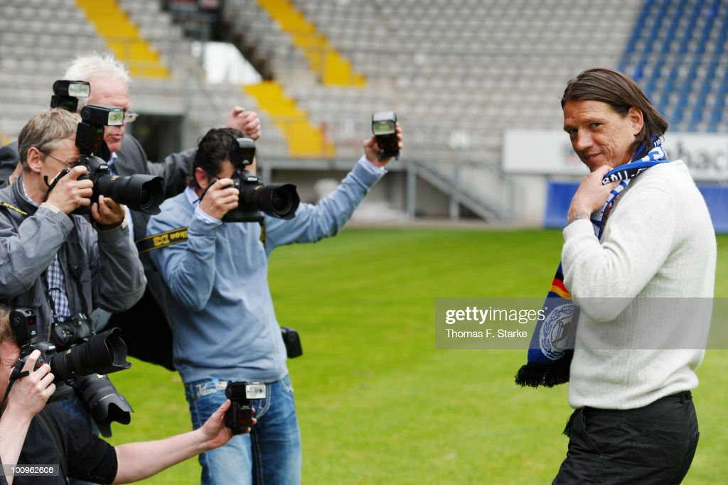New head coach of Arminia Bielefeld Christian Ziege poses for photographers after the press conference of Second Bundesliga club Arminia Bielefeld at...