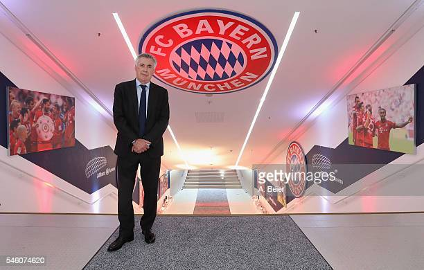 New head coach of FC Bayern Muenchen Carlo Ancelotti visits players' tunnel during his visit at the Allianz Arena stadium on July 11 2016 in Munich...