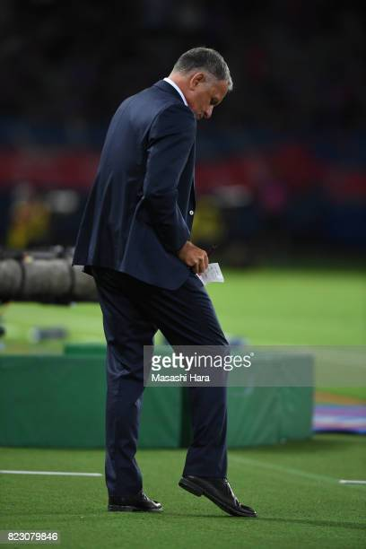 New head coach of Sanfrecce Hiroshima Jan Jonsson makes a note during the JLeague Levain Cup PlayOff Stage first leg match between FC Tokyo and...