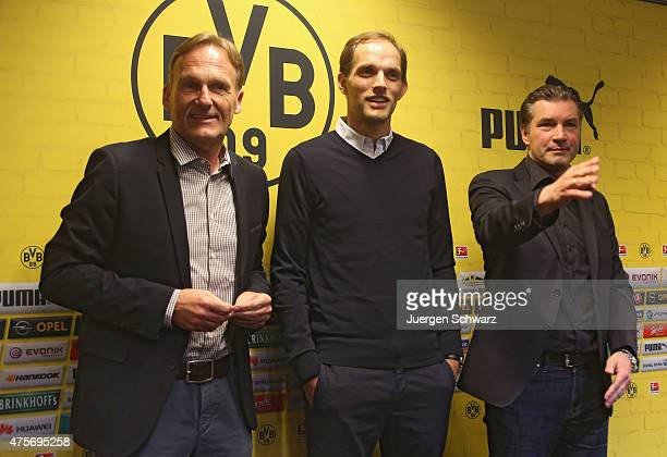 New headcoach of Borussia Dortmund Thomas Tuchel attends a news conference between CEO HansJoachim Watzke and sports director Michael Zorc at Signal...