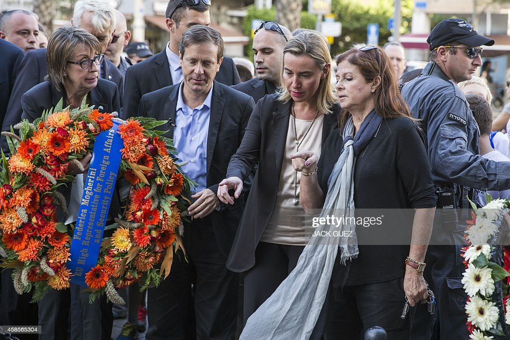 New High Representative of the European Union (EU) for Foreign Affairs and Security Policy, Federica Mogherini (C) speaks Dalia Rabin (2nd-R), daughter of Yitzhak Rabin, and Israeli opposition leader and chairman of Israel's Labor party, Isaac Herzog (2nd-L) at the memorial site where late Israeli prime minister Yitzhak Rabin was assassinated, in November 1995, in the Israeli Mediterranean coastal city of Tel Aviv on November 7, 2014. Mogherini is on an official visit to Israel and the Palestinian territories during which she has held talks with officials from both sides. AFP PHOTO / JACK GUEZ
