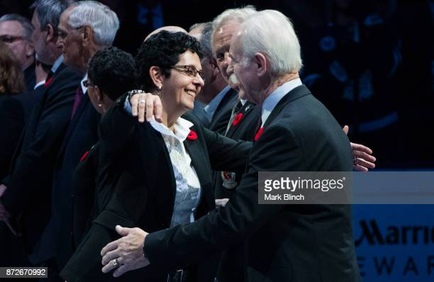New Hockey Hall of Fame member Danielle Goyette hugs Hockey Hall of Fame Chairman Lanny McDonald at the Air Canada Centre on November 10 2017 in...