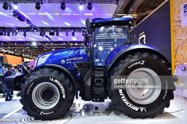 A New Holland NH Drive concept autonomous tractor is displayed during the SIMA Paris International agribusiness show at the Parc des Expositions...