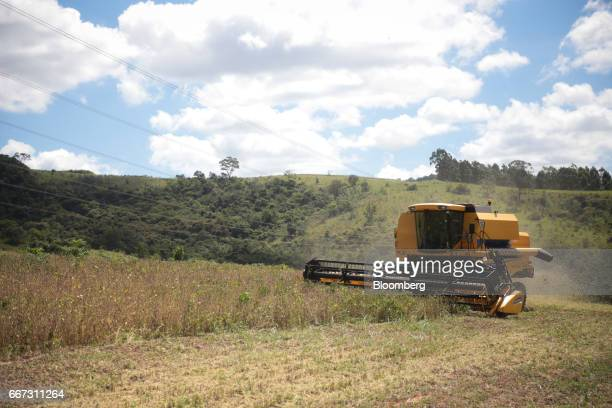 A New Holland Tractor Ltd combine machine harvests soybeans at the Santa Cruz farm near Atibaia Brazil on Wednesday March 29 2017 Brazil is world's...