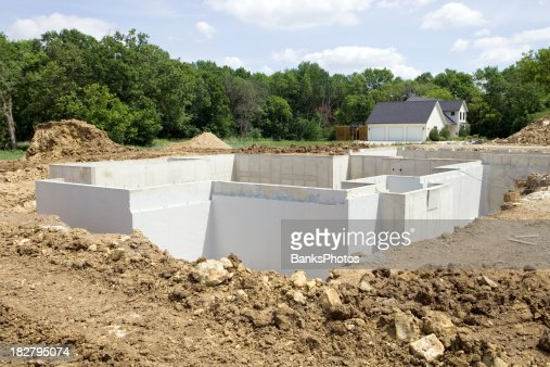 Digging a basement stock photos and pictures getty images for Building a basement foundation