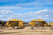 New homes being built in Phoe, Arizona under a beautiful sky.