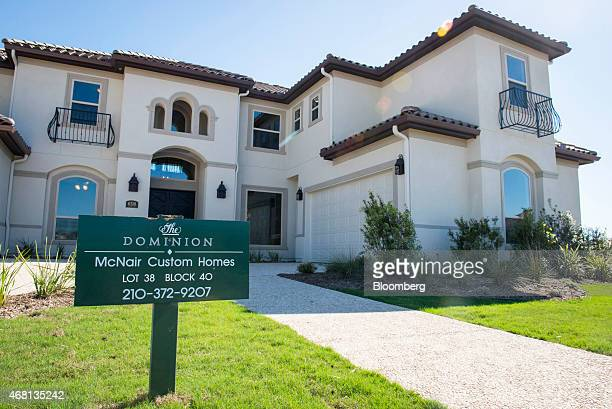A new home for sale stands in the Andalucia neighborhood of The Dominion gated community in San Antonio Texas US on Saturday March 28 2015 More...