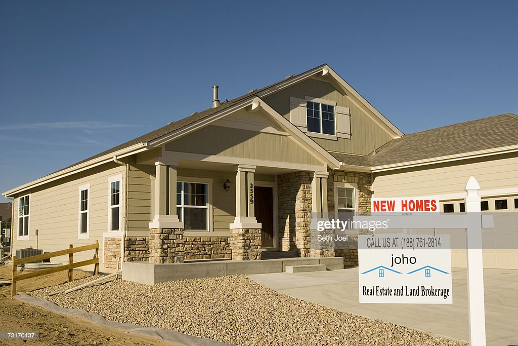 New home sign posted in front of house stock photo getty for New home sign
