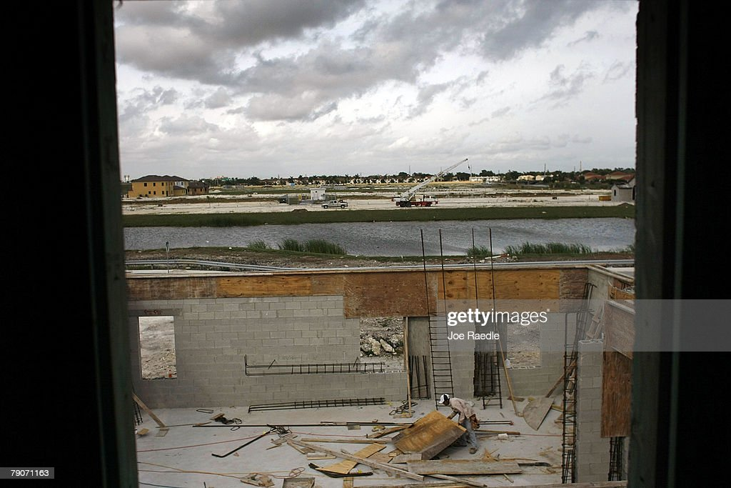 New homes are seen under construction as workers continue to build January 17, 2008 in Miami, Florida. The Commerce Department released figures showing that new home construction is down 24.8 percent from 2006.