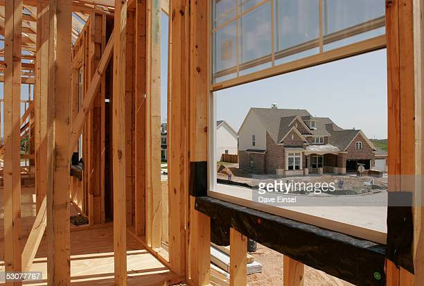 New homes in different phases of completion stand in the Magnolia Creek subdivision June 16 2005 in League City Texas The US Commerce Department...