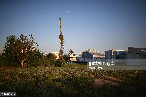 New homes stand next to vacant lots in the Lower Ninth Ward on August 26 2015 in New Orleans Louisiana President Obama is scheduled to visit the...